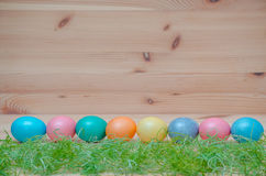 Happy easter eggs pastel colored with grass on the Royalty Free Stock Photography
