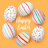 Happy Easter eggs in a row with text. Colorful easter eggs in circle on golden background. hand font. Royalty Free Stock Photo