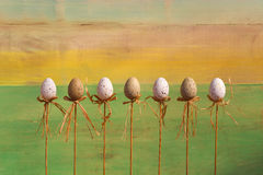Happy Easter Eggs on Sticks Green Background Stock Photo