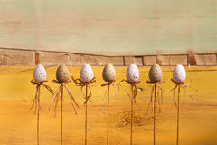 Happy Easter Eggs on Sticks Yellow Background Royalty Free Stock Image