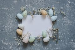Happy easter. Easter eggs with white sheet of paper, top view. Copy space royalty free stock photos