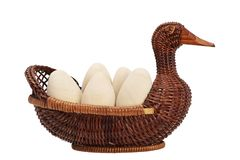Easter eggs in a wicker basket. duck wicker. wooden egg. Stock Images