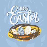 Happy Easter elegant lettering or holiday wish handwritten with cursive calligraphic font and eggs lying in nest on blue. Background. Hand drawn vector Stock Photo