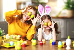 Happy easter! family mother and child with ears hare getting ready for holiday. Happy easter! family mother and child daughter with ears hare getting ready for royalty free stock image