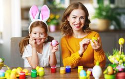 Happy easter! family mother and child with ears hare getting ready for holiday stock images