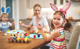 Happy easter! family mother and children paint eggs for   holida Royalty Free Stock Photography
