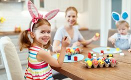Happy easter! family mother and children paint eggs for   holida Royalty Free Stock Image