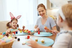 Happy easter! family mother and children paint eggs for   holida Stock Images
