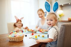 Happy easter! family mother and children paint eggs for   holida Royalty Free Stock Photo