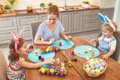 Happy easter! family mother and children paint eggs for holida stock image