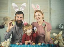 Happy easter family paint eggs. stock images