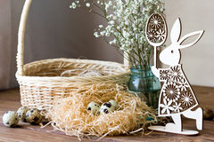 Happy Easter! Festive composition with Easter eggs on wooden background. Royalty Free Stock Photography