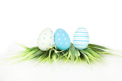 Happy Easter - few eggs on the grass, on the white background Royalty Free Stock Image