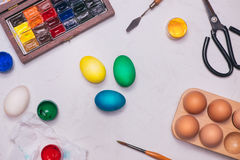 Happy Easter! Friends painting Easter eggs on table. Stock Images