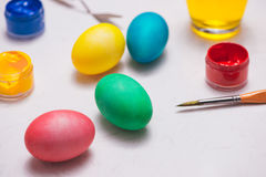 Happy Easter! Friends painting Easter eggs on table. Royalty Free Stock Photos