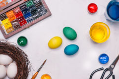 Happy Easter! Friends painting Easter eggs on table. Royalty Free Stock Photography