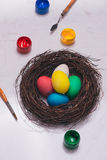 Happy Easter! Friends painting Easter eggs on table. Stock Photos