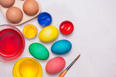 Happy Easter! Friends painting Easter eggs on table. Royalty Free Stock Photo