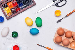 Happy Easter! Friends painting Easter eggs on table. stock photography