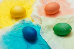 Happy Easter! Friends painting Easter eggs on table. stock image