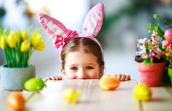 Happy easter! funny child girl with rabbit ears and . eggs royalty free stock images