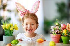 Happy easter! funny child girl with rabbit ears and eggs stock image