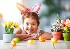 Happy easter! funny child girl with rabbit ears and . eggs stock photo
