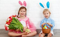 Happy easter! funny funny children   with ears hare getting read. Happy easter! funny funny children boy and girl with ears hare getting ready for holiday Royalty Free Stock Photos