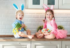 Happy easter! funny funny children  l with ears hare getting rea. Happy easter! funny funny children boy and girl with ears hare getting ready for holiday Royalty Free Stock Image