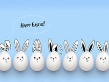 Happy Easter funny cute rabbits with easter eggs on light blue background