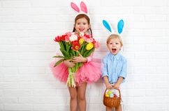 Happy easter! funny funny children   with ears hare getting read. Happy easter! funny funny children boy and girl with ears hare getting ready for holiday Royalty Free Stock Photography