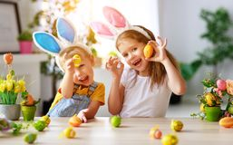 Happy easter! funny funny children with ears hare getting ready for holiday. Happy easter! funny funny children boy and girl with ears hare getting ready for royalty free stock image