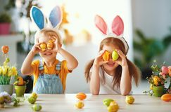Happy easter! funny funny children with ears hare getting ready for holiday. Happy easter! funny funny children boy and girl with ears hare getting ready for stock image