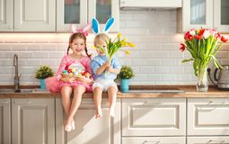 Happy easter! funny funny children  l with ears hare getting rea. Happy easter! funny funny children boy and girl with ears hare getting ready for holiday Royalty Free Stock Photography