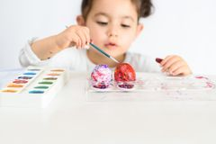 Colouring eggs for easter time at home. stock photography