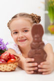 Happy easter girl with chocolate bunny. And dyed eggs - closeup Royalty Free Stock Images