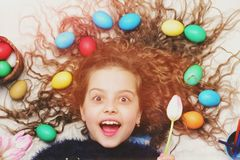 Happy easter girl, colorful eggs in long hair, tulip flowers Stock Photos
