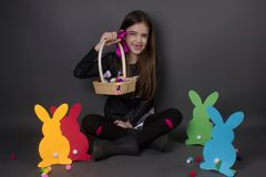Happy easter girl isolated with easter decoration. Paper bunnies eggs Royalty Free Stock Images