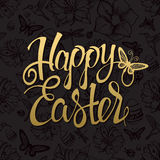 Happy Easter gold sign, symbol, logo on black background Stock Photography