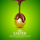 Happy Easter.Golden Egg and melted chocolate. Stock Photo