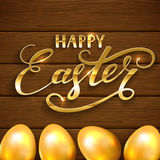 Happy Easter and golden eggs on brown wooden background Royalty Free Stock Photography