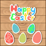 Happy Easter greeting card. Cartoon text Happy Easter and painted eggs on wooden background. Vector illustration stock illustration