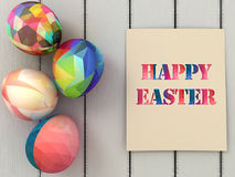 Happy Easter greeting card and Colorful easter eggs  on white wooden background. Easter greeting card design. Stock Photography