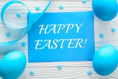 Happy Easter greeting card and colorful eggs on the wooden table stock photos