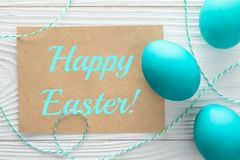 Happy Easter greeting card and colorful eggs on the wooden table. Top vi stock photos