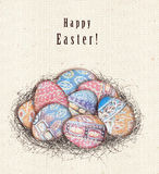 Happy Easter greeting card. Colorful ethnic eggs in bird nest. Stock Images