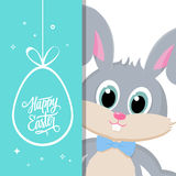 Happy Easter greeting card with easter bunny and handwritten holiday wishes. Royalty Free Stock Photos