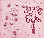 Happy Easter greeting card with eggs, feathers and ribbons at pink background, top view, with copy space for your design. Flat lay stock photos