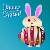 Happy Easter! Greeting Card, Funny Bunny and glass egg. Stock Image