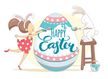 Happy Easter greeting card girl and rabbit painting Easter egg. Stock Photos